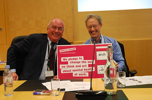 CMA Chairman, David Currie and CMA Senior Director, Adam Land signing the time to change pledge