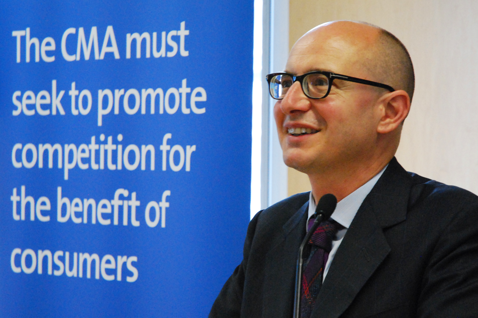 Andrea Coscelli, CEO of the CMA, in front of a board which reads, 'The CMA must seek to promote competition for the benefit of consumers'