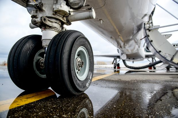 Close up of airplane wheels on runway