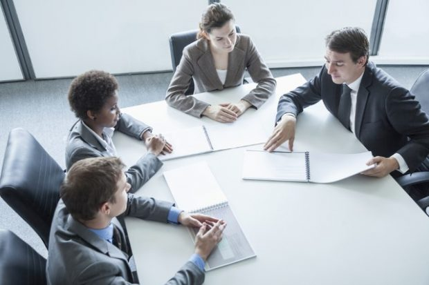 Business meeting with 4 participants in a meeting room